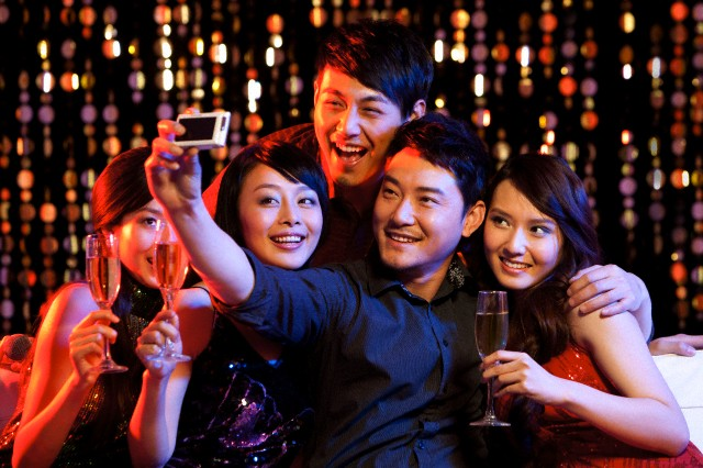 Young people taking photos in party