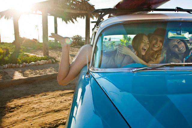 Three girls having fun in car, California, USA