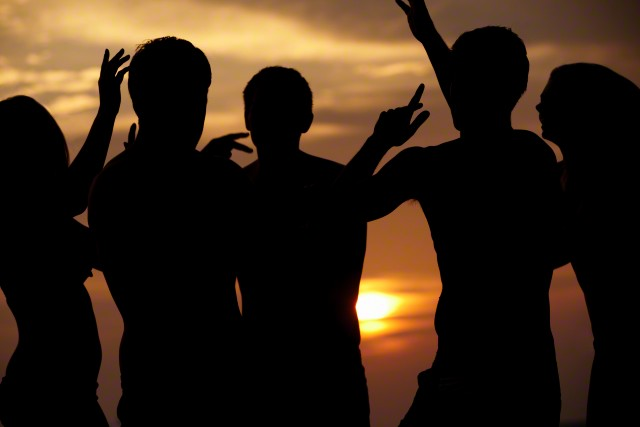 Maldives --- Silhouette Of Friends Having Beach Party --- Image by © Monkey Business Images/Corbis